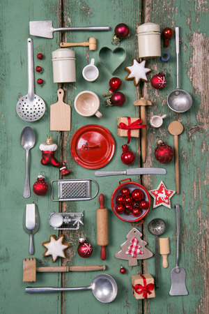 Country style or wooden vintage Christmas background in red and green for kitchen and menu decoration.