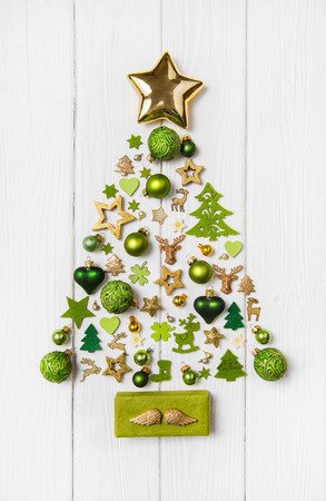 Foto de Festive christmas decoration in light green, white and golden color. Collection of xmas miniatures. - Imagen libre de derechos