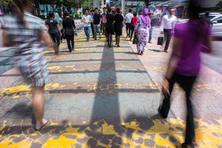 Photo for Motion Blur - People crossing the road. Blurry effect to illustrate movement - Royalty Free Image