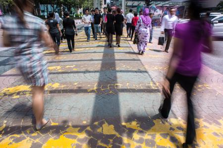 Photo pour Motion Blur - People crossing the road. Blurry effect to illustrate movement - image libre de droit