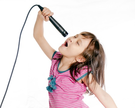 Photo for Asian female child singing with a microphone - Royalty Free Image
