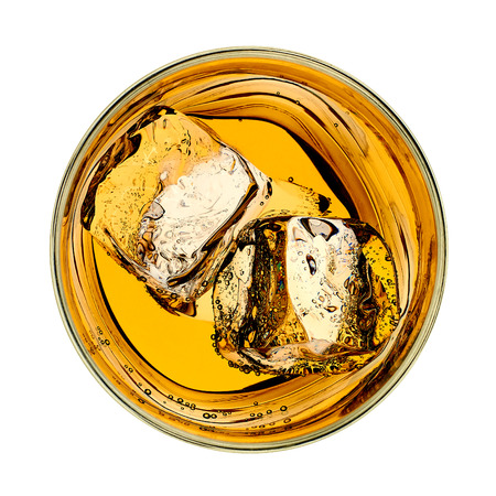 Foto de Whiskey in glass from top on white background - Imagen libre de derechos