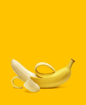 Photo pour Peeled banana on yellow background with copy space - image libre de droit