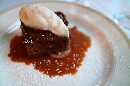 Photo for Sticky ginger pudding  with ice cream on top for dessert - Royalty Free Image