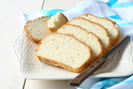 Photo for Fresh from the oven sliced gluten free bread on plate - Royalty Free Image