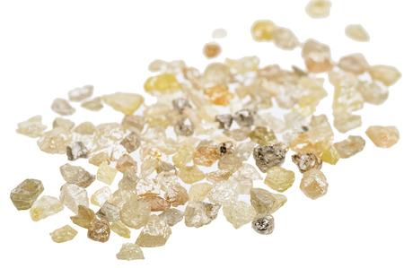 Foto de A pile of raw, uncut natural diamonds on white - Imagen libre de derechos