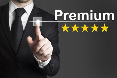 businessman in black suit pushing flat touchscreen button premium star rating