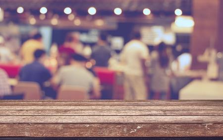 Foto de Empty wood table top with restaurant blur with bokeh background,Product display template - Imagen libre de derechos