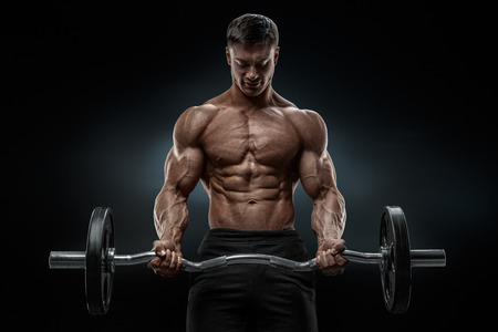 Photo pour Closeup portrait of a muscular man workout with barbell at gym. Brutal bodybuilder athletic man with six pack perfect abs shoulders biceps triceps and chest. Deadlift barbells workout. - image libre de droit
