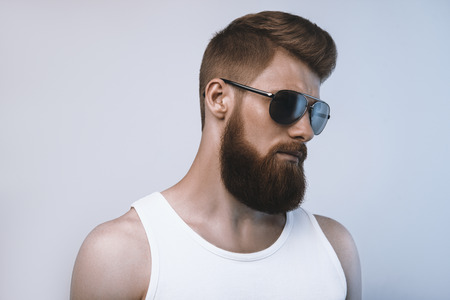 Photo pour Bearded man wearing sunglasses. Studio shot on white background - image libre de droit