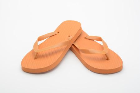 Photo pour Orange flipflops on white background - image libre de droit