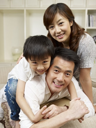 loving asian family having fun at home
