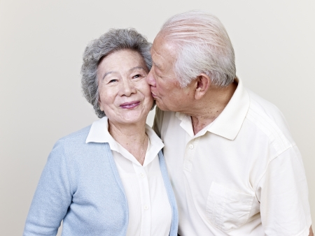 Photo for portrait of a senior asian couple kissing - Royalty Free Image