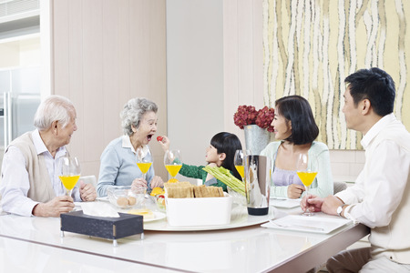 Photo pour three-generation family having meal at home - image libre de droit