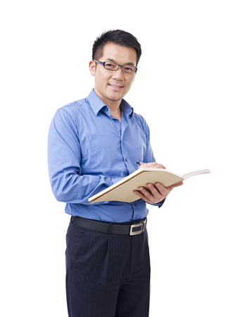 Photo pour asian man with pen and notebook, isolated on white  - image libre de droit
