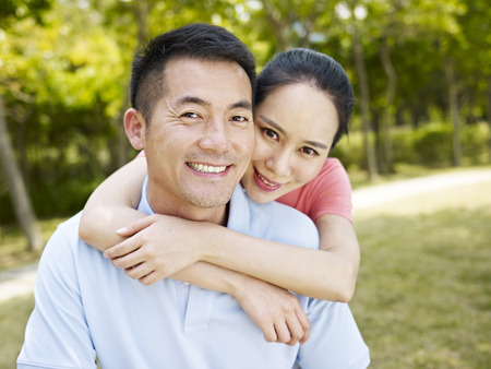 Photo for portrait of an asian couple in park - Royalty Free Image