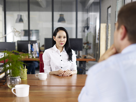 Photo for young asian businesswoman looking serious and nervous during a job interview. - Royalty Free Image