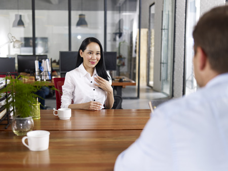 Photo for young asian businesswoman looking confident making a self introduction during a job interview. - Royalty Free Image