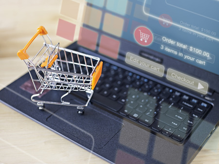 Photo pour toy shopping cart on keyboard of laptop computer for online shopping and e-commerce concept. - image libre de droit
