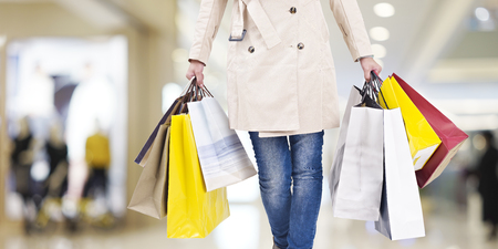 Photo pour woman with colorful shopping bags walking in modern mall. - image libre de droit