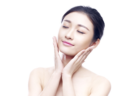 Photo for studio portrait of a young asian woman, eyes closed, hands on chins, isolated on white. - Royalty Free Image