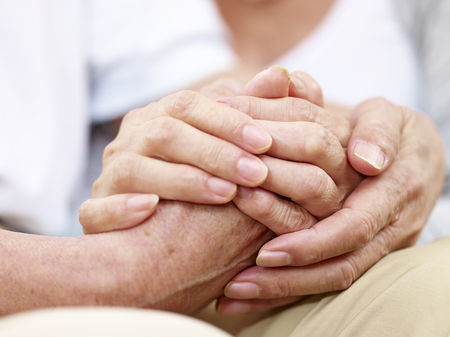 Photo pour close-up of hands of a senior couple held together, concept for love, help, comforting and consoling - image libre de droit