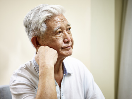 Photo for portrait of sad senior asian man hand on chin, side view. - Royalty Free Image