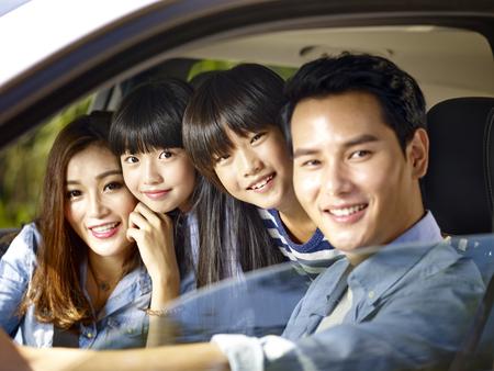 Photo pour happy asian family with two children riding in a car - image libre de droit
