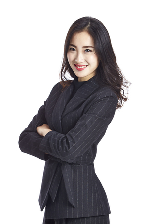Foto de studio portrait of a young beautiful asian business woman, arms crossed, looking at camera smiling, isolated on white background. - Imagen libre de derechos