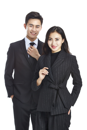 Photo for studio portrait of two young asian corporate executive, businessman and businesswoman, looking at camera smiling, isolated on white background. - Royalty Free Image