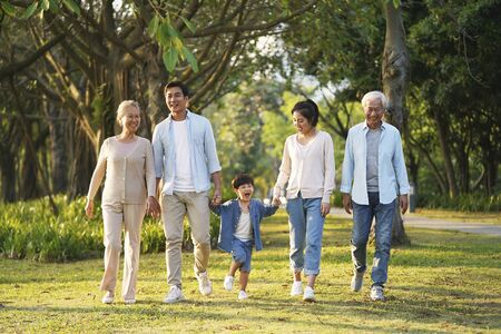 Photo for three generation happy asian family walking outdoors in park - Royalty Free Image