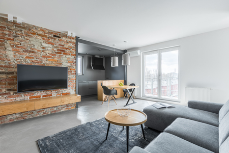 Photo for Living room with industrial brick wall and gray sofa - Royalty Free Image