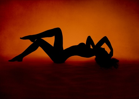 Photo for Naked sexy woman silhouette lying at red orange background - Royalty Free Image
