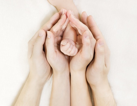 Photo for Parent's hands holding baby's hand - Royalty Free Image