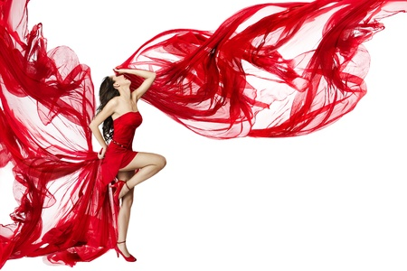 Photo pour Beautiful woman dancing in red dress flying on a wind flow over white background - image libre de droit