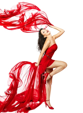 Woman  in red dress dancing with fabric flying on a wind flow. White Isolated
