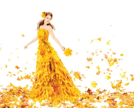 Autumn woman in fashion dress of maple leaves holding bouquet  leaves.