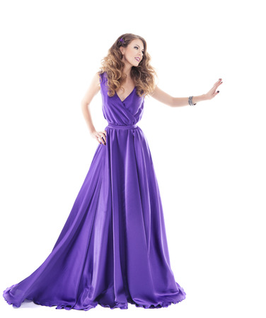 Photo for Woman showing advertisement in purple silk dress isolated over white background  - Royalty Free Image