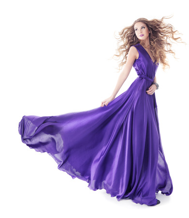 Photo pour Woman in purple silk waving dress walking over isolated white background  - image libre de droit