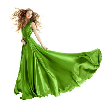 Foto de Woman in beauty fashion green gown, long evening dress over isolated white background  - Imagen libre de derechos