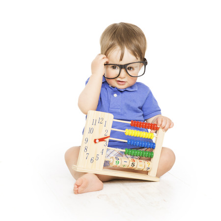 Foto de Boy child with abacus clock in glasses counting, smart little kid study lesson, education concept - Imagen libre de derechos