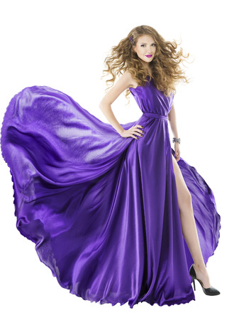Foto de Woman silk dress, long fluttering train, girl purple fabric clothes with long hairs, isolated over white background  - Imagen libre de derechos