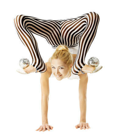 Photo for circus gymnast woman flexible body standing on arms upside down, balancing balls on feet. Isolated white background - Royalty Free Image