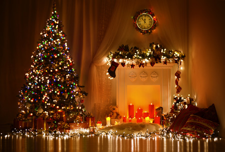 Photo for Christmas Room Interior Design, Xmas Tree Decorated By Lights Presents Gifts Toys, Candles And Garland Lighting Indoors Fireplace - Royalty Free Image