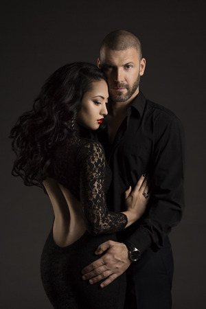 Photo for Couple Man and Woman in Love, Fashion Beauty Portrait of Models Embracing over Black Background - Royalty Free Image