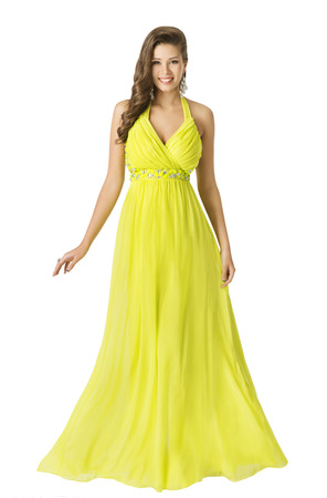 Foto de Woman Beauty Long Fashion Dress, Elegant Girl In Yellow Summer Gown, Young Beautiful Model with Long Hair Isolated Over White Background - Imagen libre de derechos