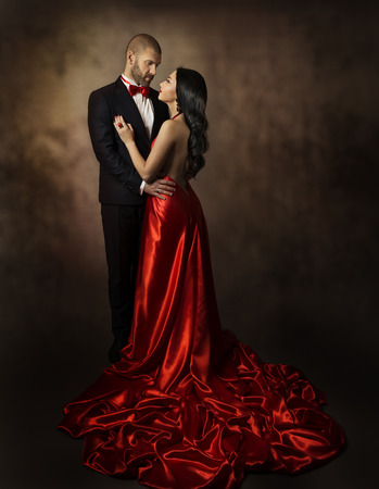 Photo for Couple in Love, Lovers Woman and Man, Glamour Classic Suit and Dress with Long Tail, Fashion Beauty Portrait of Young Models, Well Dressed in Valentine Day - Royalty Free Image