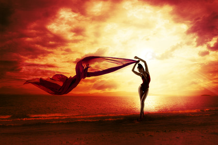 Photo pour Sexy Woman Silhouette over Red Sunset Sky, Sensual Female on Beach, Vacation Holiday Concept, Girl with Windy Flying Cloth - image libre de droit