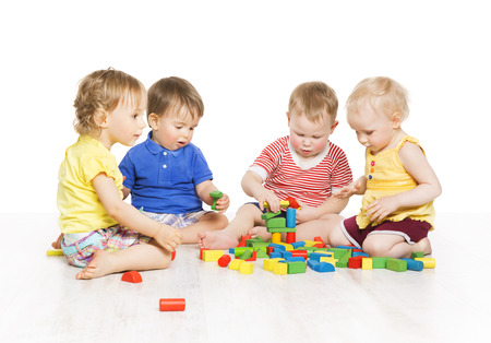 Foto de Children Group Playing Toy Blocks. Little Kids Early Development. Baby Activity One Year Old Games, Isolated Over White Background - Imagen libre de derechos