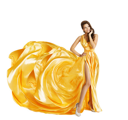 Photo for Woman in Yellow Art Silk Dress, Surprised Girl Looking Sideways, Gown Cloth Fabric as Flower, Beauty Model Isolated over White - Royalty Free Image